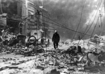 A fireman walks through rubble on a Napier street following the 1931 quake