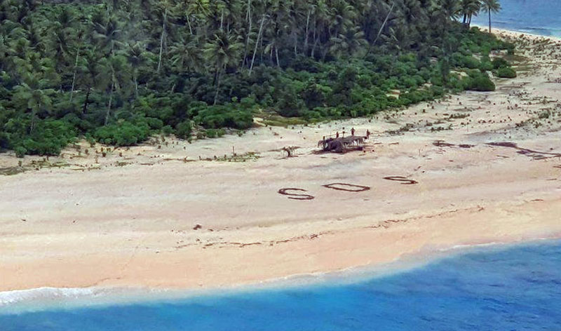 SOS spelled out on beach by castaway fishermen